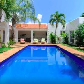Large home in hacienda style in gated community